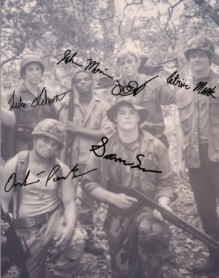 Luke Selmont (far top left) and his friends, amateur actors, are all dressed up in their military costumes post-shooting for his short film.