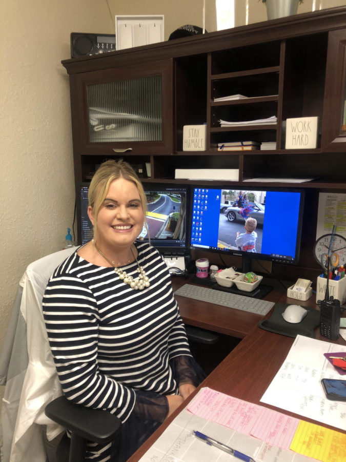 Mrs. Stone in her office. Her moniter displays the security tapes from various cameras on campus. Her son, Colt, is the desktop background of the computer.  Photo credit: Scherkenbach
