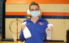 Coach Lee is equipped with disinfectant spray and a mask.