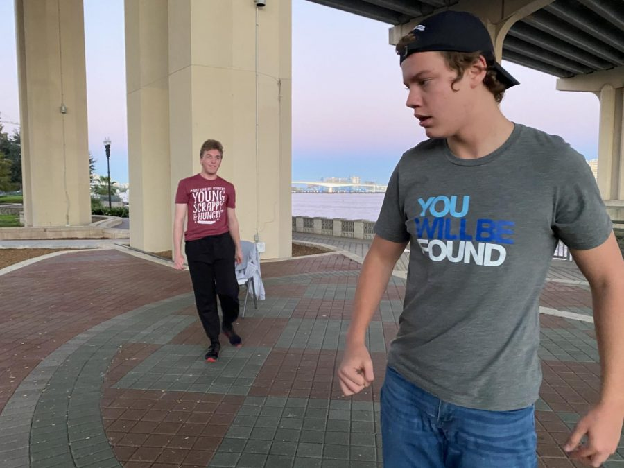 Both wearing Broadway-inspired t-shirts, Gabriel Bassin (right) rehearses with Jake McGraw (left).