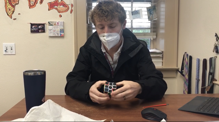Mr. Gebauer can solve a cube in 1 minute and 11 seconds.