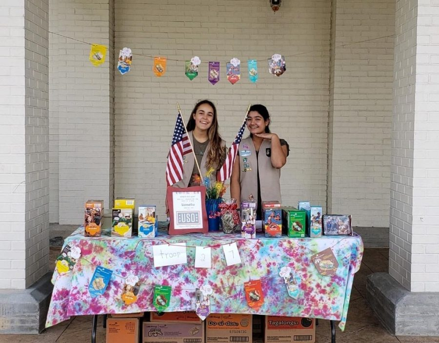 Blisko '22 (left) and Peiris '22 (right) have both been Girl Scouts since elementary school. They are seen here selling cookies.