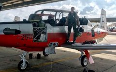 Gaitantzis proudly stands on the wing of her T-9 while it is being fueled and looked over.