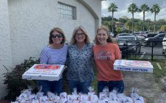 For Homecoming week, the moms brought pizza and treats for the football team.
