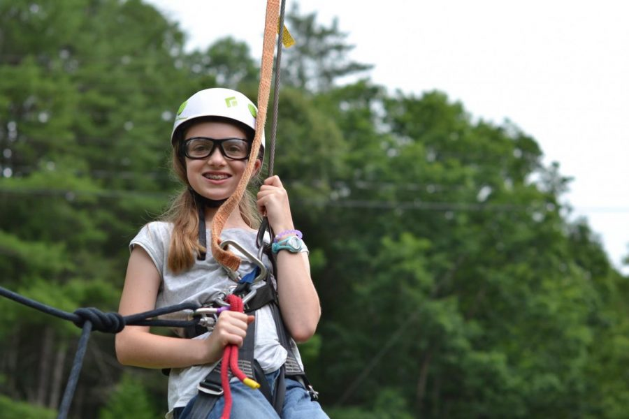 I am rock climbing at summer camp in 2017 before sixth grade.