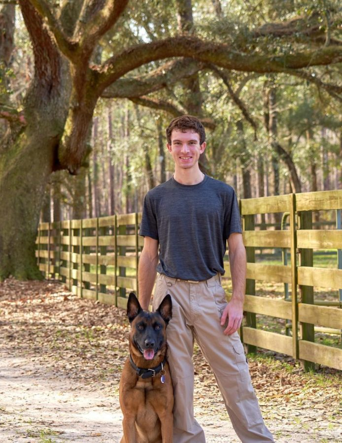 """Me standing in the road on the way to a dog training """"interview"""" with my dog, Draco."""